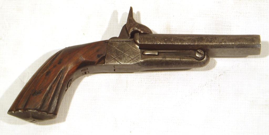 Pistola SIN MARCA, modelo de 2 cañones basculantes, calibre 7 mm., nº 72-0
