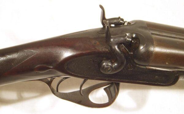 Escopeta J. PURDEY AND SONS, modelo THUMBOLE UNDERLEVER, calibre 12, nº 10174-2611